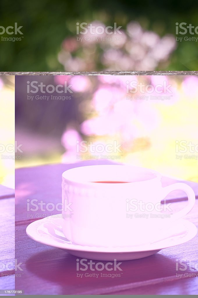 English country garden with a cuppa tea. royalty-free stock photo