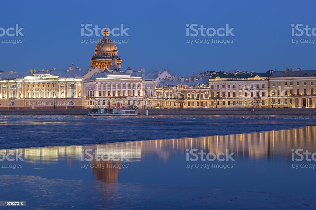English Embankment and Saint Isaac's Cathedral at sunset, St. Petersburg stock photo