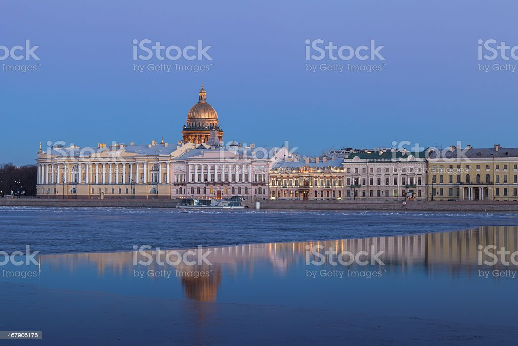 English Embankment and Saint Isaac's Cathedral, St. Petersburg at sunset stock photo