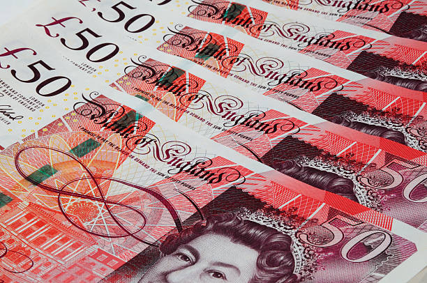English fifty pound notes. England, UK - December 31, 2015: Close up of English sterling fifty pound notes, England, UK, Western Europe. british currency stock pictures, royalty-free photos & images