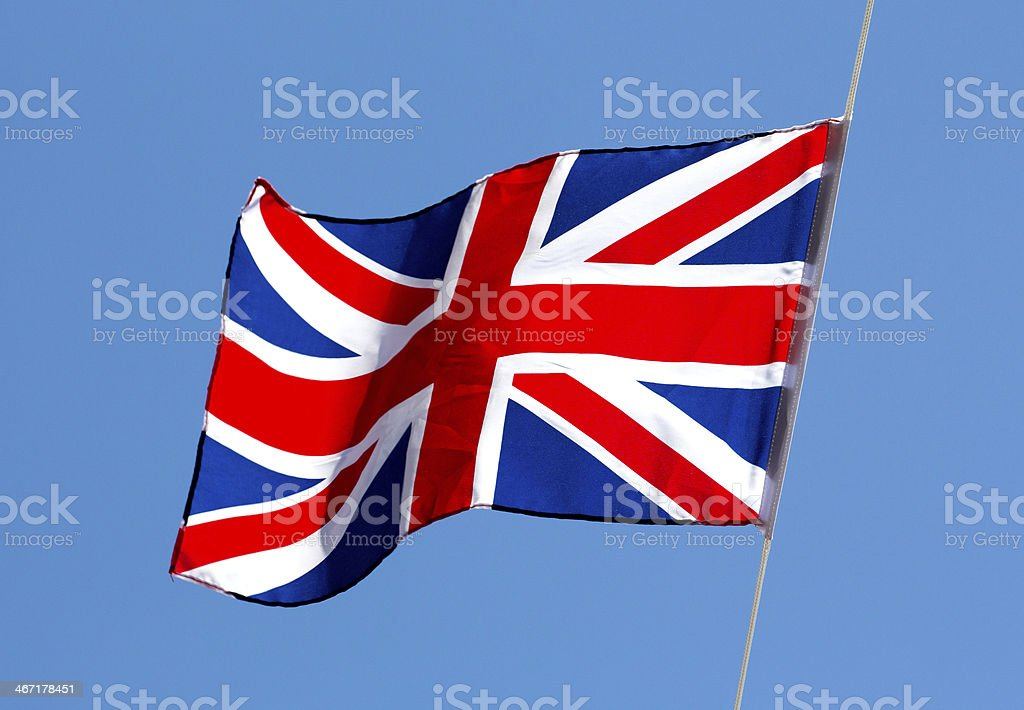 English flag in the wind against a sky royalty-free stock photo