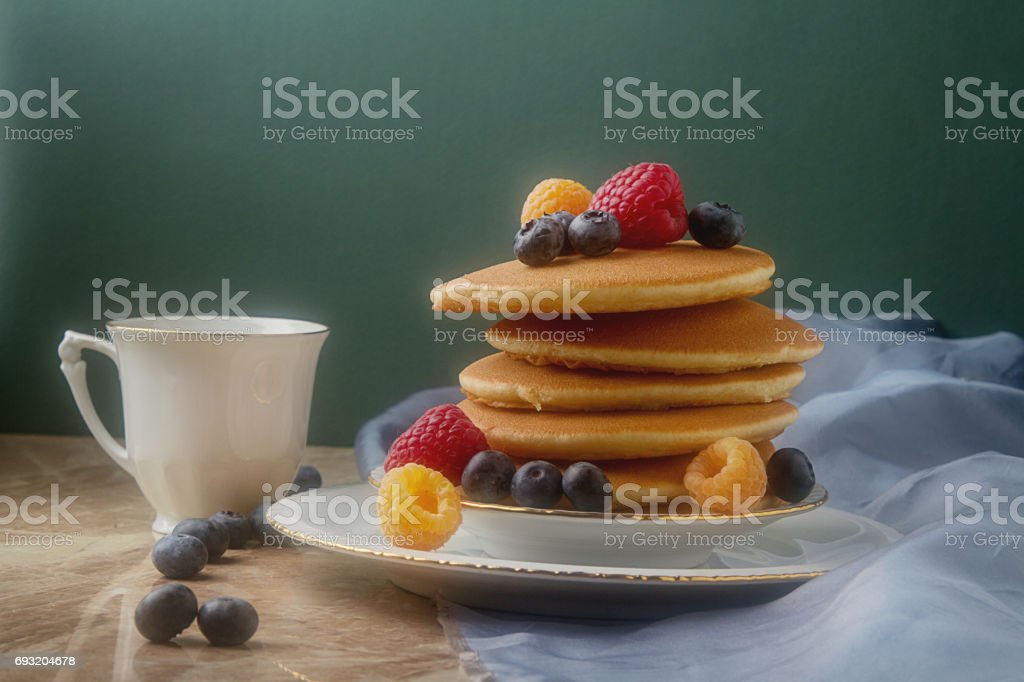English Fresh Homemade Pancakes With Raspberries Blueberries Mint On