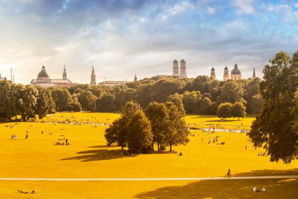 English garden and Munich skyline panoramic view stock photo