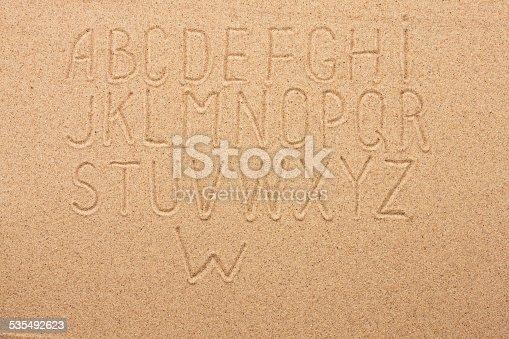 istock English, German, Portuguese alphabet  written on the sand 535492623