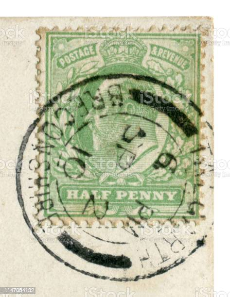 Talgarth, Brecknockshire, United Kingdom of Great Britain - circa 1910: English historical stamp: green half penny stamp with a portrait of the king, Edward VII, 1910 black ink cancellation, Royal mail