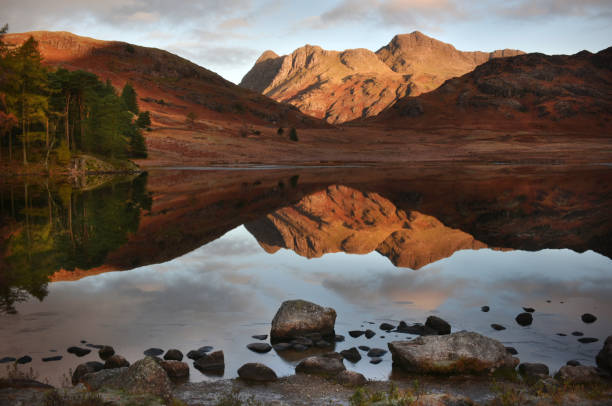 English Lake district dawn Blea Tarn in the English Lake district -autumn dawn reflections reflection lake stock pictures, royalty-free photos & images