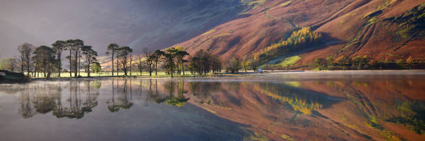 English Lake District panorama Autumn colour at Buttermere Lake in the English Lake District. Cumbria, UK reflection lake stock pictures, royalty-free photos & images