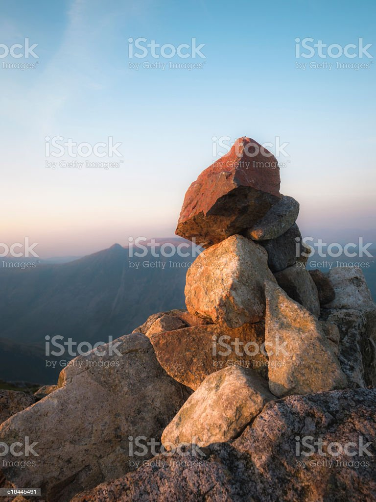 English Lake District: Pike of Blisco cairn at sunset stock photo