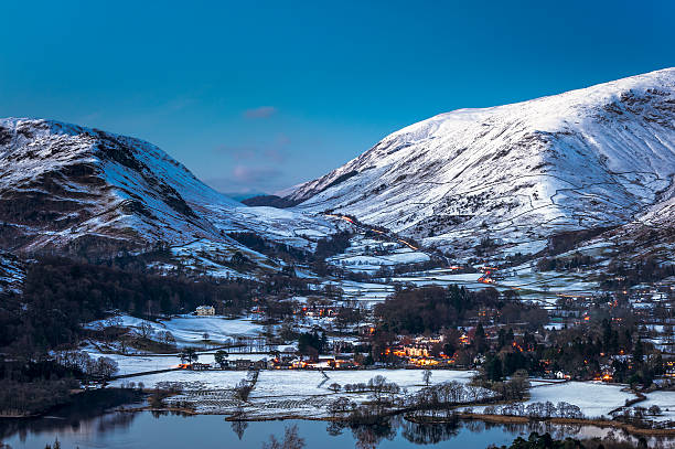 English Lake District: wintry Grasmere at dusk Clear, wintry skies at dusk in Grasmere, in the English Lake District. Long exposure. cumbria stock pictures, royalty-free photos & images