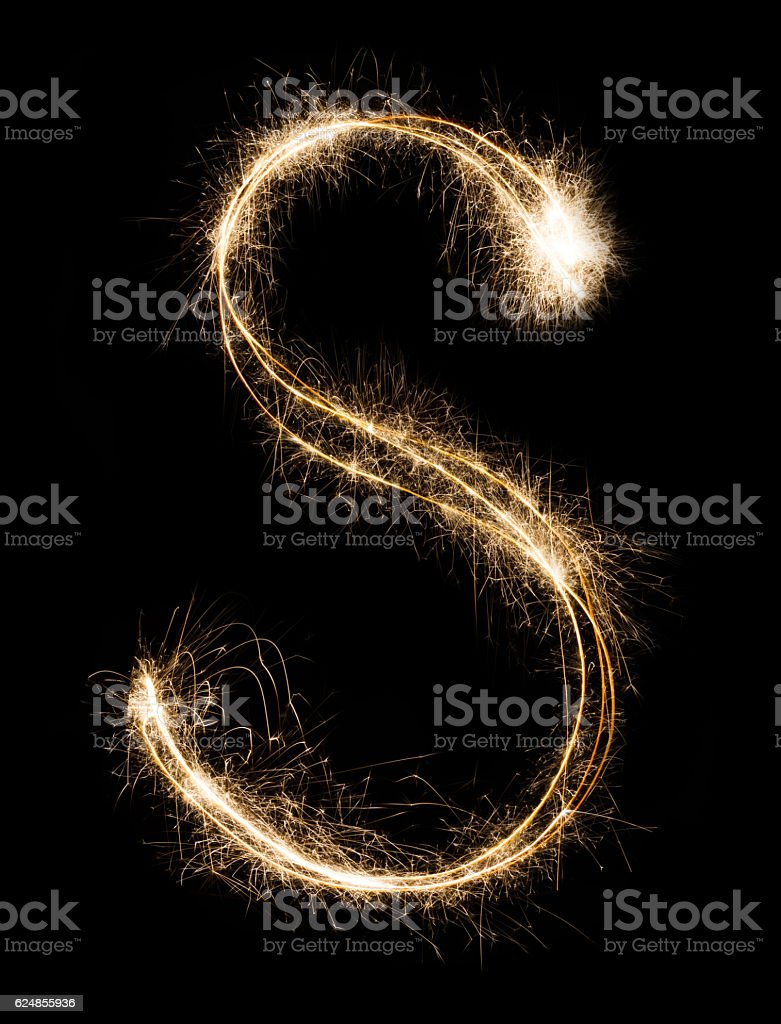 English Letter S from sparklers alphabet on black background. stock photo