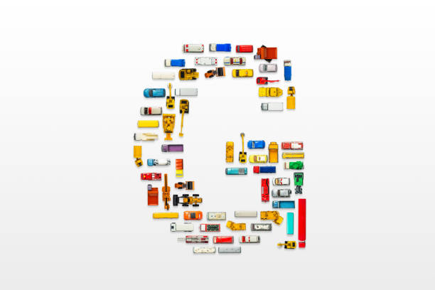 English letters formed by arrangement of Car toy diecast on the white background , Top view . English letters formed by arrangement of Car toy diecast on the white background , Top view . three wheel motorcycle stock pictures, royalty-free photos & images