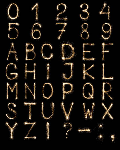 english letters from sparklers, alphabet and numbers on black background. - lightweight stock photos and pictures