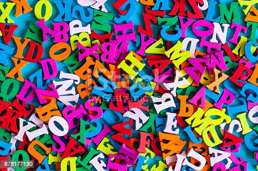 istock English letters on blue background composed from colorful abc alphabet leter. Learning english or other language concept. 678177130