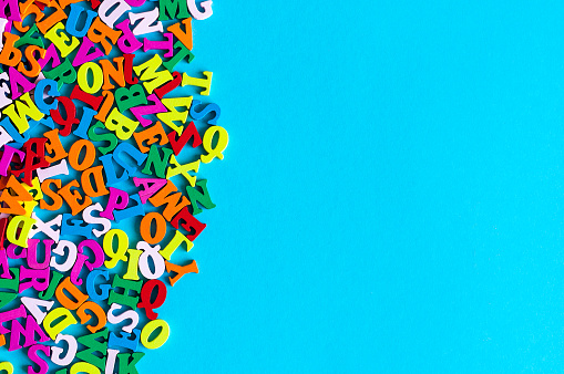 istock English letters on blue background composed from colorful abc alphabet leter. Back to school concept or Learning english or other language courses. Empty space, Copy space 690573114