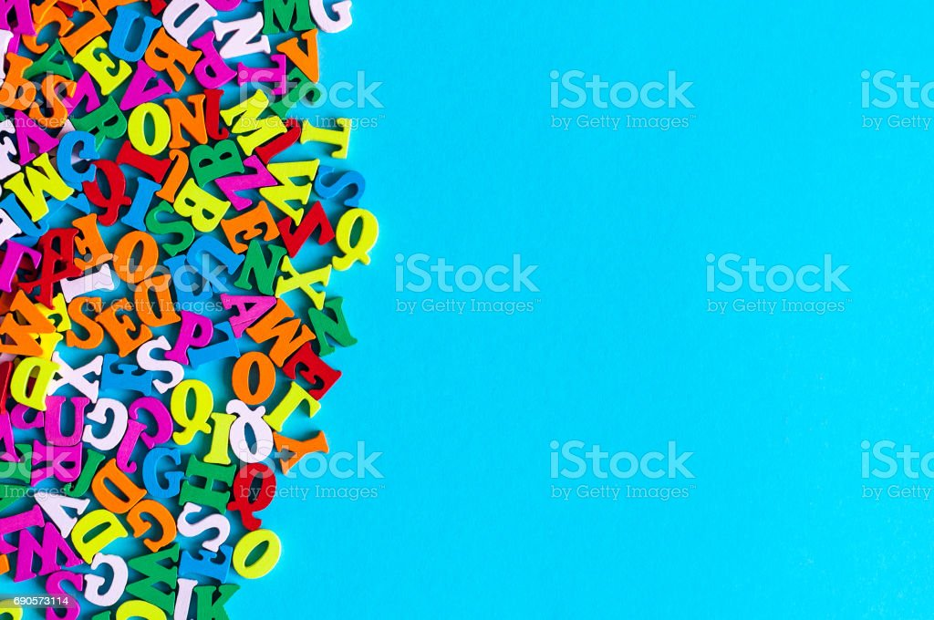 English letters on blue background composed from colorful abc alphabet leter. Back to school concept or Learning english or other language courses. Empty space, Copy space stock photo