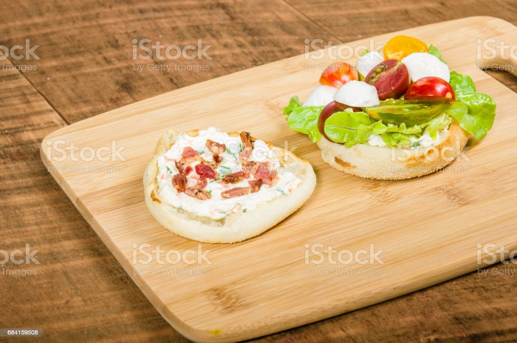 English muffin with heirloom tomatoes royalty-free stock photo