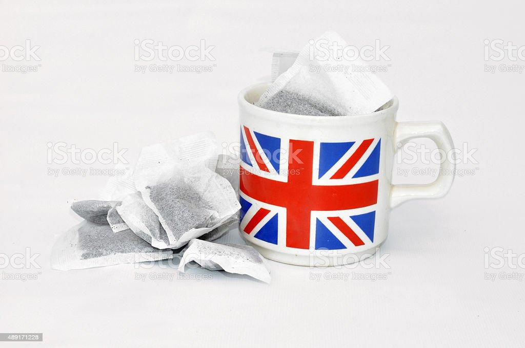 English Mug with Tea Bags Inside stock photo