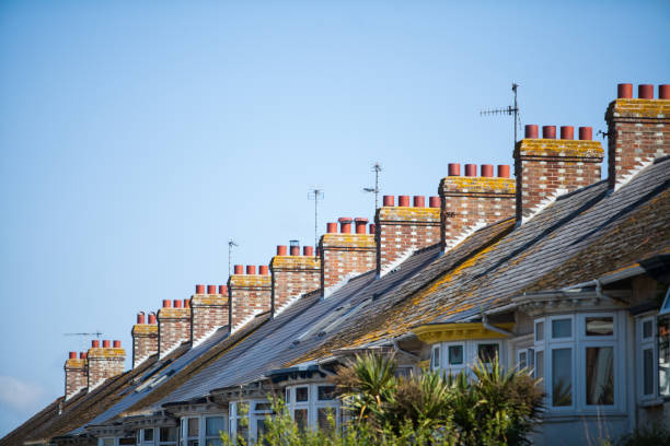 English row of houses with chimneys stock photo