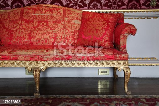 Antique settee with evidence of wear and tear in Adam style with original silk upholstery and gold paint during the English Georgian period