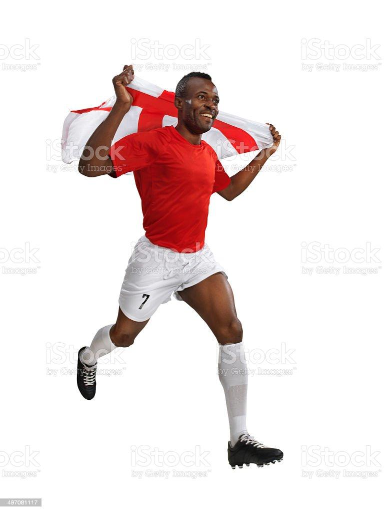 Jogador de futebol com bandeira de corridas depois de Vitória - foto de acervo