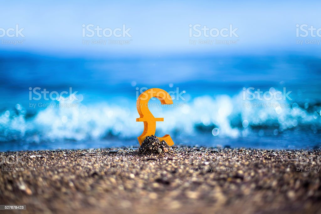 English Sterling is standing on the wavy sea side stock photo