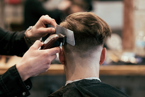 istock English style barber shop action 1147618941