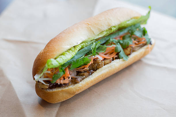 Vietnamese Sub Banh mi A healthy sub sandwich / Vietnamese banh mi filled with meat and healthy veggies vietnamese culture stock pictures, royalty-free photos & images