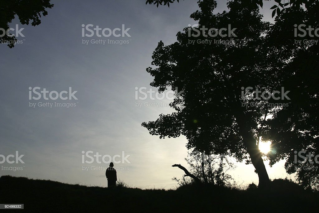 English sunset with person on hill royalty-free stock photo