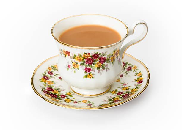 english tea in a bone china cup - theekop stockfoto's en -beelden