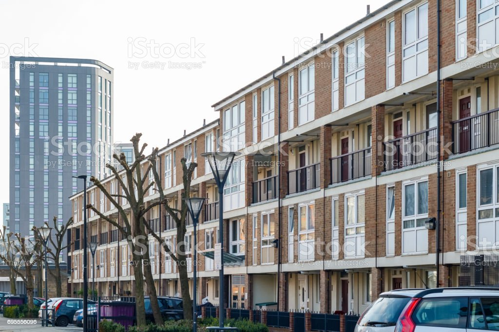 English terraced houses in contrast to modern luxury flats in the background stock photo