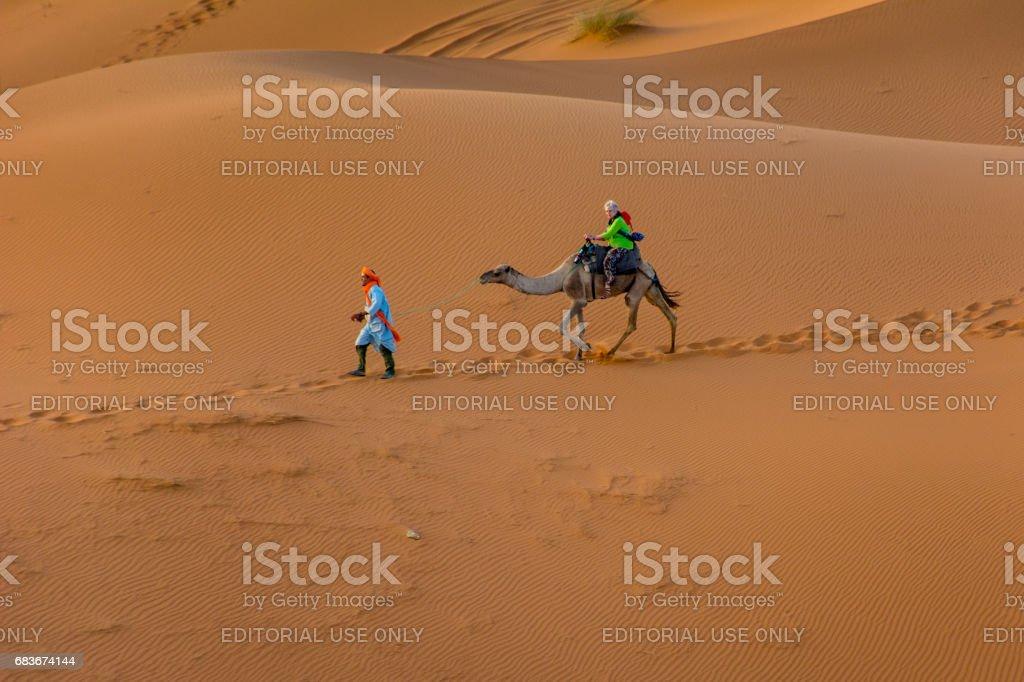 English Tourist On a Camel at Erg Chebbi stock photo