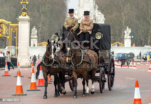 istock English traditional Coach of 19th century with two horses and coachman. London 674807322