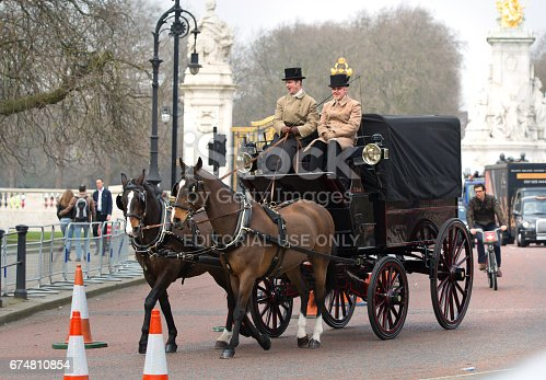 istock English traditional Coach of 19th century with two horses and coachman. London 674810854