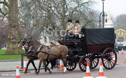 istock English traditional Coach of 19th century with two horses and coachman. London 674811250