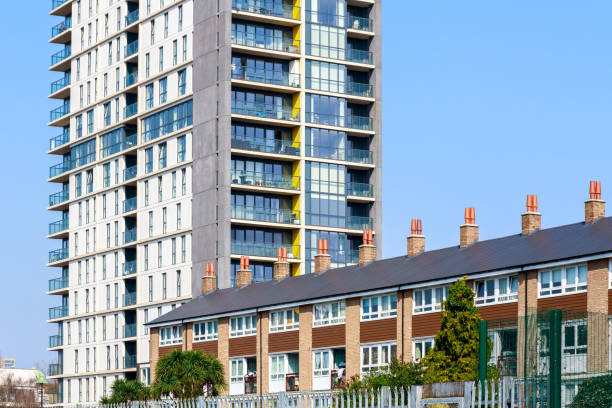 English traditional terraced houses contrasted with a modern high-rise flats stock photo