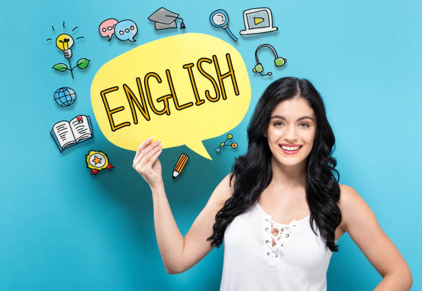 English with woman holding a speech bubble English with young woman holding a speech bubble english language stock pictures, royalty-free photos & images