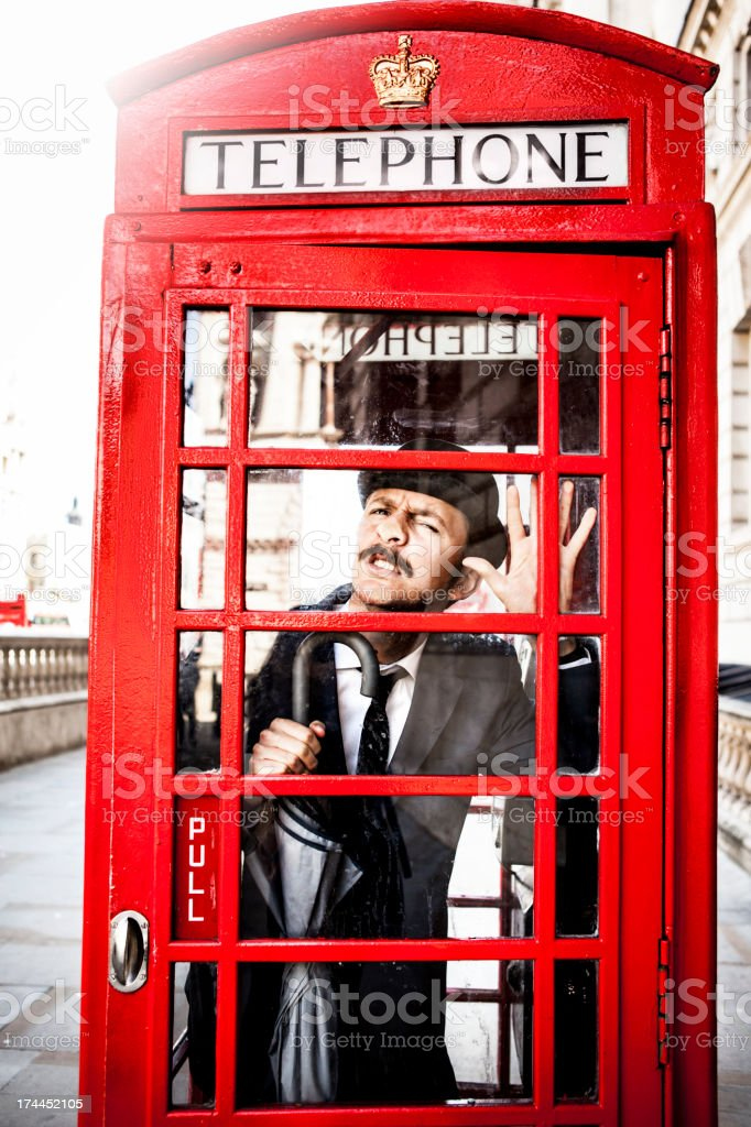 Englishman trapped in Red Telephone Box stock photo