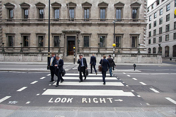 """Englishmen """"London, UK - July 26, 2011: English office workers cross the street on Pall Mall July 26, 2011 in London, UK"""" civil servant stock pictures, royalty-free photos & images"""