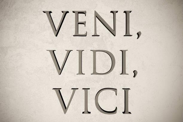 Engraved latin quote stock photo