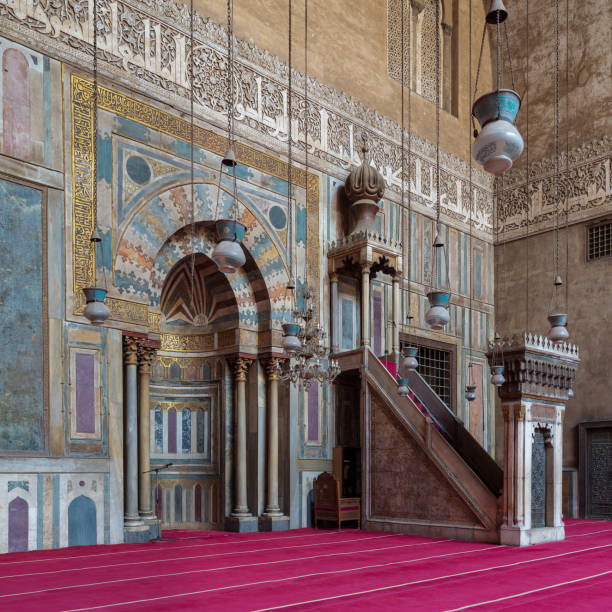 Engraved Mihrab (niche) and wooden Minbar (Platform) at the Mosque and Madrassa (School) of Sultan Hassan, Cairo, Egypt stock photo