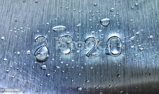 istock 2020 engraved on an aluminum foil with water droplets 1169044902