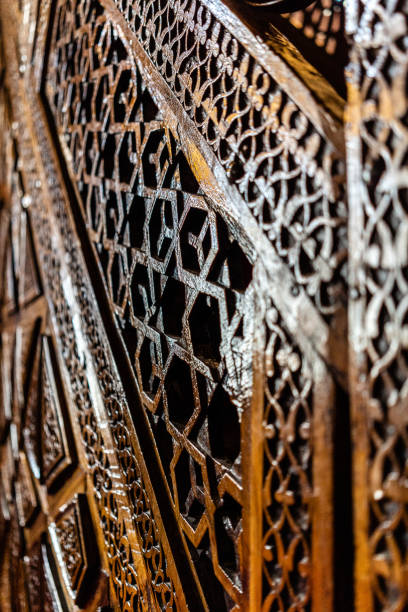 engraved wooden minbar/pulpit in the historical mosque stock photo