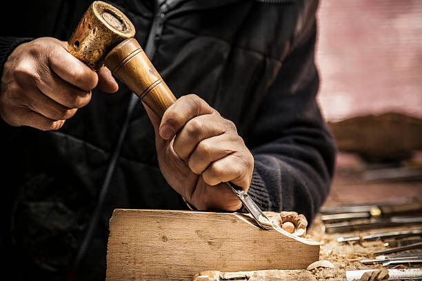 Engraver - Wood working An engraver is carving a piece of wood frame carving craft product stock pictures, royalty-free photos & images
