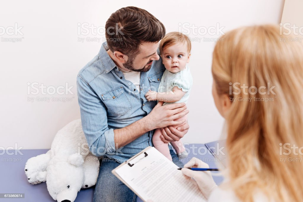 Enigmatical baby making funny faces stock photo