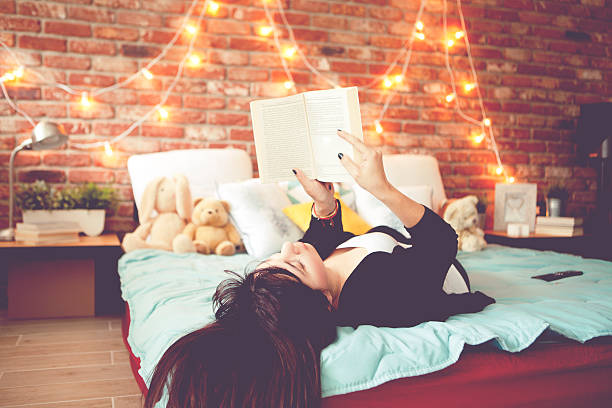 Enjoy at home Cute female enjoy at home reading a book girl bedroom stock pictures, royalty-free photos & images