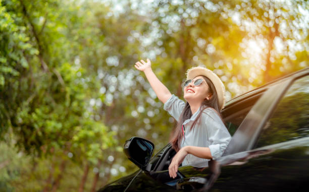 enjoy car travel of woman driving with sunglasses journey at nature forest in summer vacation road trip on holidays to destination, traveler transportation vehicle people lifestyle - gmail imagens e fotografias de stock