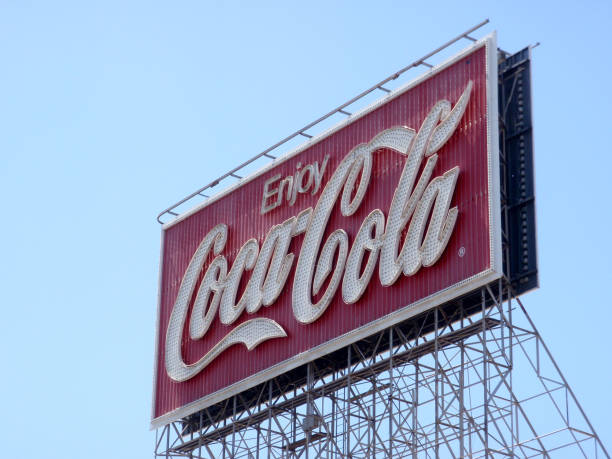 Enjoy Coca-Cola Neon Sign during the day against a blue sky stock photo
