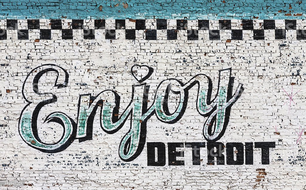 Enjoy Detroit sign on wall stock photo