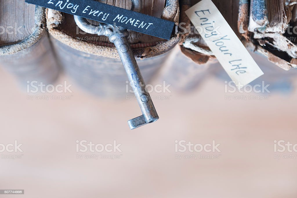 Enjoy every moment text and key stock photo