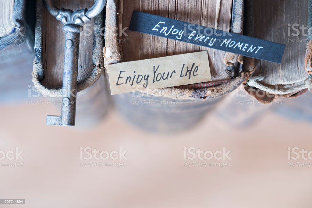 Enjoy every moment text stock photo